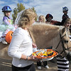 Roxann Deutch hands out candy to Alexandrea Waugh, 3, and other special needs children while they trick or treat on horseback around the neighborhood of the Miracles Therapeutic Riding Center for Halloween on Saturday.<br /> October 30, 2010<br /> staff photo/David R. Jennings