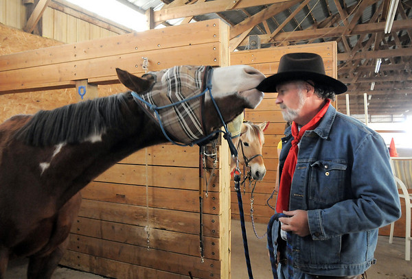 Stuart, a therapeutic horse, takes the hat off of Kevin Hall after they helped special needs trick or treat on horseback around the neighborhood of the Miracles Therapeutic Riding Center for Halloween on Saturday.<br /> October 30, 2010<br /> staff photo/David R. Jennings