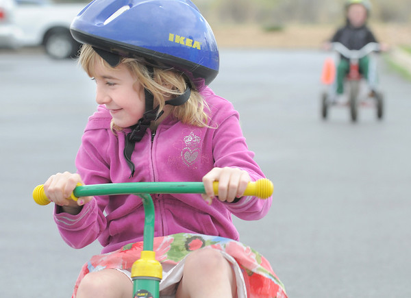 Harlie Mazucca smiles while riding her tricycle around the track with other kindergarteners during the Cross of Christ Preschool  Trike-a-Thon on Thursday as a fundraiser for St. Jude Children's Hospital.<br /> <br /> <br /> April 12, 2012 <br /> staff photo/ David R. Jennings