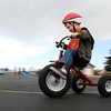 Trey Boychuk makes the trun on the track  during the Cross of Christ Preschool  Trike-a-Thon on Thursday as a fundraiser for St. Jude Children's Hospital.<br /> <br /> <br /> April 12, 2012 <br /> staff photo/ David R. Jennings