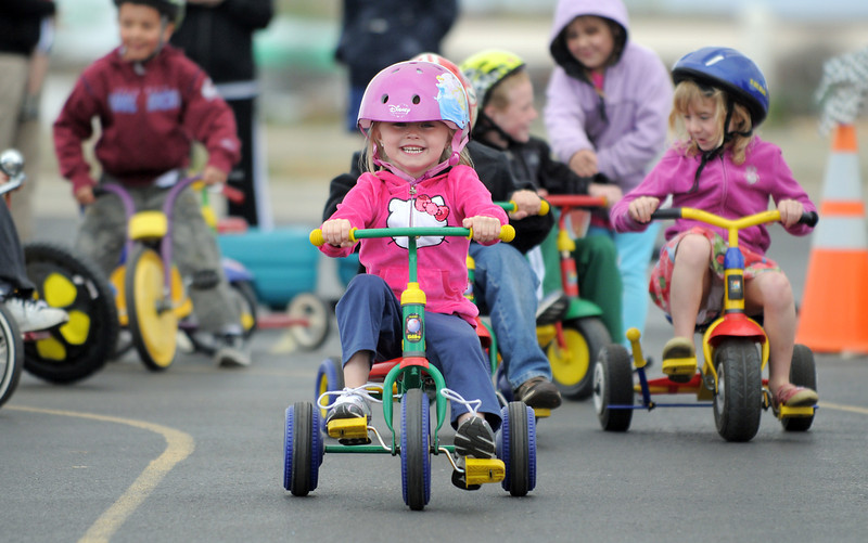 Talan Bauman takes the lead of the kindergarten pack racing around the track  during the Cross of Christ Preschool  Trike-a-Thon on Thursday as a fundraiser for St. Jude Children's Hospital.<br /> <br /> <br /> April 12, 2012 <br /> staff photo/ David R. Jennings