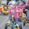 Kindergartener Talan Bauman smiles while racing around the track during the Cross of Christ Preschool  Trike-a-Thon on Thursday as a fundraiser for St. Jude Children's Hospital.<br /> <br /> <br /> April 12, 2012 <br /> staff photo/ David R. Jennings