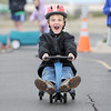 Kindergartener Isaac Philipsen yells while gliding down the track during the Cross of Christ Preschool Trike-a-Thon on Thursday as a fundraiser for St. Jude Children's Hospital.<br /> <br /> <br /> April 12, 2012 <br /> staff photo/ David R. Jennings