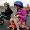 Harlie Mazucca, center, pauses while Bryce Newham, left,  stears around her while Trey Boychuk rides up from behind during the Cross of Christ Preschool  Trike-a-Thon on Thursday as a fundraiser for St. Jude Children's Hospital.<br /> <br /> <br /> April 12, 2012 <br /> staff photo/ David R. Jennings