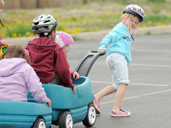 Nora Rozgany pulls classmates around the track during the Cross of Christ Preschool  Trike-a-Thon on Thursday as a fundraiser for St. Jude Children's Hospital.<br /> <br /> <br /> April 12, 2012 <br /> staff photo/ David R. Jennings
