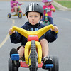 "Noah Orcutt concentrates while stopping at a ""traffic light"" during the Cross of Christ Preschool  Trike-a-Thon on Thursday as a fundraiser for St. Jude Children's Hospital.<br /> <br /> <br /> April 12, 2012 <br /> staff photo/ David R. Jennings"