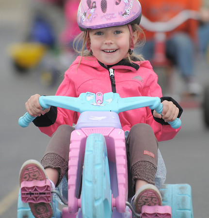 Olivia Thomas races around the track with fellow kindergarteners during the Cross of Christ Preschool  Trike-a-Thon on Thursday as a fundraiser for St. Jude Children's Hospital.<br /> <br /> <br /> April 12, 2012 <br /> staff photo/ David R. Jennings