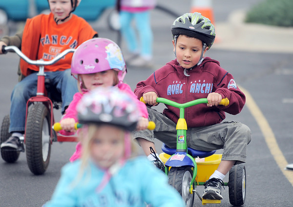 Josh Stirm, right, in the crowd of tricycle riding kindergarten classmates during the Cross of Christ Preschool  Trike-a-Thon on Thursday as a fundraiser for St. Jude Children's Hospital.<br /> <br /> <br /> April 12, 2012 <br /> staff photo/ David R. Jennings
