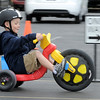Noah Orcutt steers his big wheel past a one way sign during the Cross of Christ Preschool  Trike-a-Thon on Thursday as a fundraiser for St. Jude Children's Hospital.<br /> <br /> <br /> April 12, 2012 <br /> staff photo/ David R. Jennings