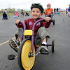 Josh Stirm concentrates while racing around the track with fellow kindergarteners during the Cross of Christ Preschool  Trike-a-Thon on Thursday as a fundraiser for St. Jude Children's Hospital.<br /> <br /> <br /> April 12, 2012 <br /> staff photo/ David R. Jennings