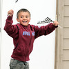 Kindergartener Josh Stirm waves finish flags as the end of the Cross of Christ Preschool  Trike-a-Thon on Thursday as a fundraiser for St. Jude Children's Hospital.<br /> <br /> <br /> April 12, 2012 <br /> staff photo/ David R. Jennings