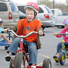 Kindergartener Trey Boychuk puts some steam in to his effort while racing around the track  during the Cross of Christ Preschool  Trike-a-Thon on Thursday as a fundraiser for St. Jude Children's Hospital.<br /> <br /> <br /> April 12, 2012 <br /> staff photo/ David R. Jennings