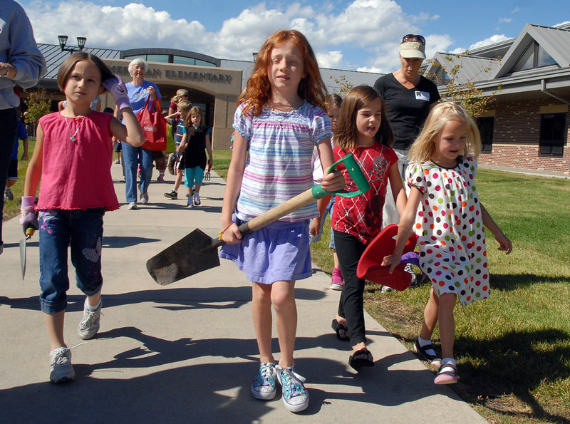 Meridian Elementary first graders lead by Kera Bensky holding a shovel walk to the area they will be planting tulips at the school on Friday. <br /> October 8, 2010<br /> staff photo/David R. Jennings