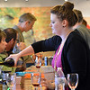 Kristin Bueb pours wine during the Turquoise Mesa Winery wine club tasting event on Saturday.<br /> <br /> February 2, 2013<br /> staff photo/ David R. Jennings