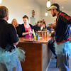 Gary Hodge, left and his son-in-law Zach Brunetti wearing tutu's, wait to sample wines at the Turquoise Mesa Winery wine club served by Kristin Bueb, center, on Saturday.<br /> Wine tasters who wore tutu's in conjunction with 2/2/2013 were given a prize for their efforts.<br /> February 2, 2013<br /> staff photo/ David R. Jennings