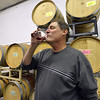 Owner Tom Bueb tastes a sample of wine from a barrel during the Turquoise Mesa Winery wine club tasting event on Saturday. Turquoise Mesa Winery moved to a new location at 117th Ave. and Teller St.<br /> <br /> February 2, 2013<br /> staff photo/ David R. Jennings