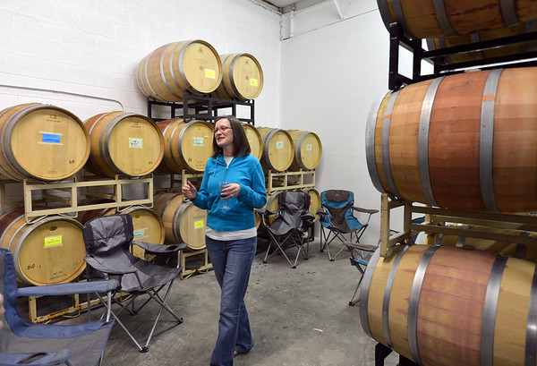 Kristina Crain samples Turquoise Mesa Winery wines from the barrels during the Turquoise Mesa Winery wine club tasting event on Saturday. Turquoise Mesa Winery moved to a new location at 117th Ave. and Teller St.<br /> <br /> February 2, 2013<br /> staff photo/ David R. Jennings