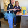 Gary Hodge and his wife Sue sample wines during the Turquoise Mesa Winery wine club tasting event on Saturday.<br /> Wine tasters who wore tutu's in conjunction with 2/2/2013 were given a prize for their efforts.<br /> February 2, 2013<br /> staff photo/ David R. Jennings
