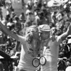 Connie Carpenter, overall women's winner, celebrates on the victory stand with men's champ Greg LaMond after the finale of Coors Bicycle Classic Monday July 6, 1981. Ronal Taniwaki, The UPI
