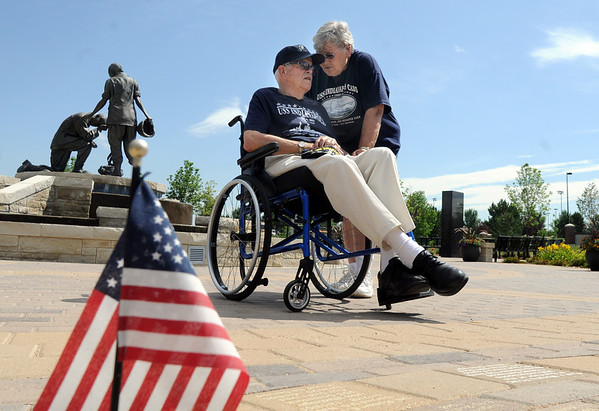 Paul Murphy has a quiet moment with his wife Mary Lou after  the World War II veteran and survivor of the sinking of the USS Indianapolis watched the placing of an engraved brick in his honor at the Westminster Armed Forces Tribute Garden on Thursday.<br /> <br /> July 22, 2010<br /> Staff photo/ David R. Jennings