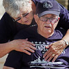 Paul Murphy is hugged by his wife Mary Lou as the World War II veteran and survivor of the sinking of the USS Indianapolis watches the placing of an engraved brick in his honor at the Westminster Armed Forces Tribute Garden on Thursday.<br /> <br /> July 22, 2010<br /> Staff photo/ David R. Jennings