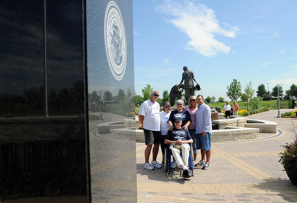 World War II veteran Paul Murphy, survivor of the sinking of the USS Indianapolis, poses for pictures with his family on Thursday at the Westminster Armed Forces Tribute Garden. Murphy was honored with an engraved brick which was placed at the US Navy portion of the garden.<br /> July 22, 2010<br /> Staff photo/ David R. Jennings