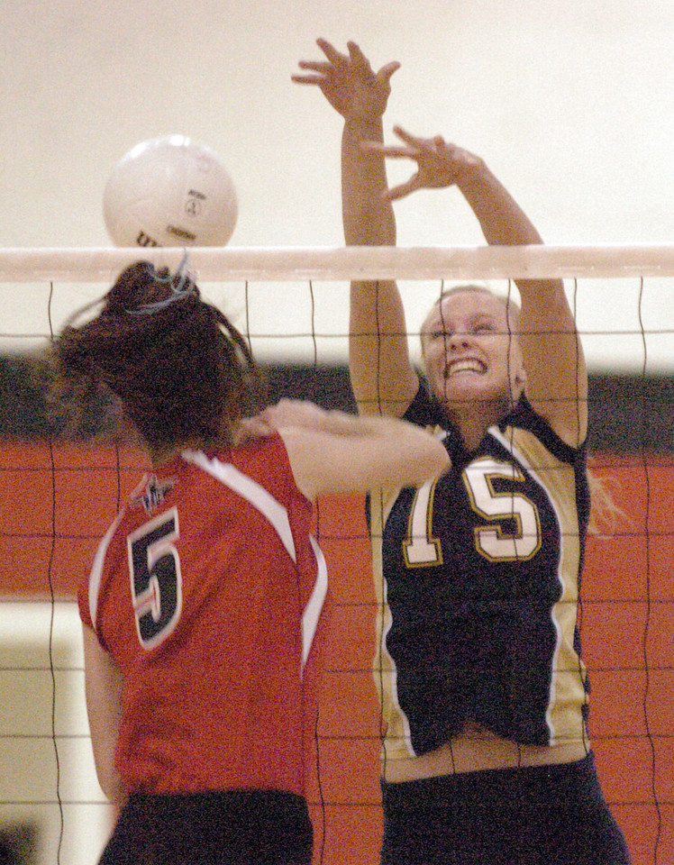 Legacy's Sarah Dunahay tries to block the ball from Fairview's Kelsey Spencer during Tuesday's game at Fairview.<br /> <br /> October 12, 2010<br /> staff photo/David R. Jennings