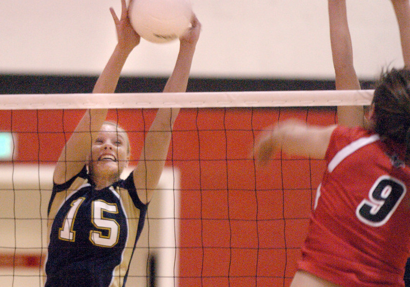 Legacy's Sarah Dunahay blocks the ball from Nicole Edelman, Fairview during Tuesday's game at Fairview.<br /> <br /> October 12, 2010<br /> staff photo/David R. Jennings