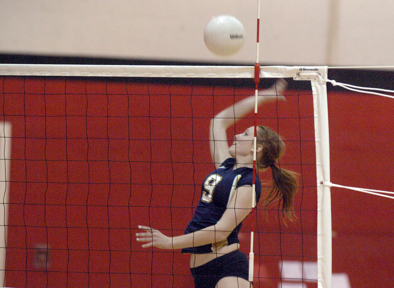 Legacy's Kendra Weiss spikes the ball against Fairview during Tuesday's game at Fairview.<br /> <br /> October 12, 2010<br /> staff photo/David R. Jennings
