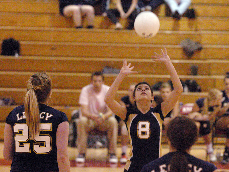 Legacy's Hilda Taheran sets the ball for Lacey Stewart during Tuesday's game against Fairview at Fairview.<br /> <br /> October 12, 2010<br /> staff photo/David R. Jennings