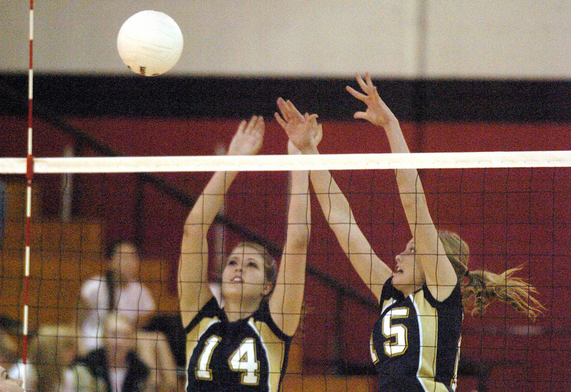 Legacy's Danielle Staudt, left, and Sarah Dunahay block the ball from Fairview during Tuesday's game at Fairview.<br /> <br /> October 12, 2010<br /> staff photo/David R. Jennings
