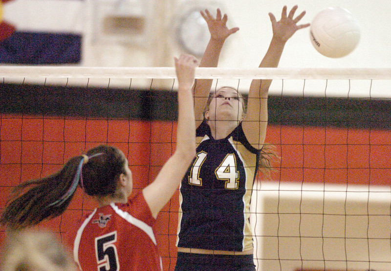 Legacy's Danielle Staudt tries to block the ball from Fairview's Kelsey Spencer during Tuesday's game at Fairview.<br /> <br /> October 12, 2010<br /> staff photo/David R. Jennings