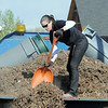 "Stacey Mulligan, North Metro Fire Rescue, scoops mulch into containers for newly planted trees in the area between North Metro Fire Rescue headquarters and Mamie Doud Eisenhower Public LIbrary during the ""Trees for a Healthy Community and Economy"" event on Saturday. <br /> <br /> April 14, 2012 <br /> staff photo/ David R. Jennings"