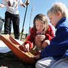 "Sarah Tutt, 7, left, and Lyle Roberts, 6, look for bugs in the dirt while a trees in being planted  in the area between North Metro Fire Rescue headquarters and Mamie Doud Eisenhower Public LIbrary during the ""Trees for a Healthy Community and Economy"" event on Saturday. <br /> <br /> April 14, 2012 <br /> staff photo/ David R. Jennings"