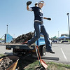 "Colette Crouse jumps off of a truck after shoveling mulch for the freshly planted trees in the area between North Metro Fire Rescue headquarters and Mamie Doud Eisenhower Public LIbrary during the ""Trees for a Healthy Community and Economy"" event on Saturday. <br /> <br /> <br /> April 14, 2012 <br /> staff photo/ David R. Jennings"
