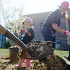 "A shovel loaded with dirt for a tree being planted with the help of Isabella Peterson, 3, left, and her mother, Katie, in the area between North Metro Fire Rescue headquarters and Mamie Doud Eisenhower Public LIbrary during the ""Trees for a Healthy Community and Economy"" event on Saturday. <br /> <br /> April 14, 2012 <br /> staff photo/ David R. Jennings"