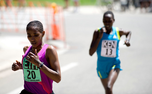 """Ethiopia's Mamitu Daska (left) edges out Kenya's Emily Chebet during the annual Bolder Boulder 10K Road Race in Boulder, Colorado, Monday, May 31, 2010. <br /> <br /> Kasia Broussalian<br /> <br /> For a video, please visit  <a href=""""http://www.dailycamera.com"""">http://www.dailycamera.com</a>"""