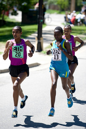 "Mamitu Daska, of Ethiopia, (left) and Emily Chebet, of Kenya, lead the pack throughout the elite race during the annual Bolder Boulder 10K Road Race in Boulder, Colorado, Monday, May 31, 2010. <br /> <br /> Kasia Broussalian<br /> <br /> For a video, please visit  <a href=""http://www.dailycamera.com"">http://www.dailycamera.com</a>"