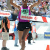 BOLDER<br /> Women's elite winner Mamitu Daska of Ethiopia crosses the finish line during the 32nd Annual Day Bolder Boulder on Monday.<br /> Photo by Marty Caivano/Camera/May 31, 2010