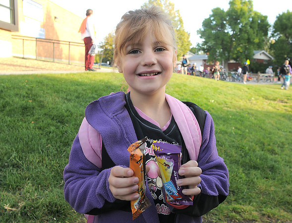 Kaylee Syddall, 6, show the granola type bars given to her for walking to Birch Elementary School during Walk To School Day on Wednesday. <br /> October 5, 2011<br /> staff photo/ David R. Jennings