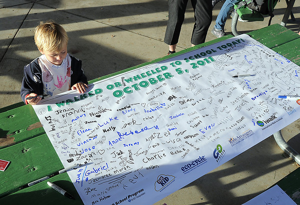 Henry Van Derberg, 4, signs the poster for the Birch Elementary School Walk To School Day on Wednesday. <br /> October 5, 2011<br /> staff photo/ David R. Jennings