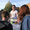 Blayne Watson with Love Grown Foods to studetns a parents at Birch Elementary School for Walk To School Day on Wednesday. <br /> October 5, 2011<br /> staff photo/ David R. Jennings