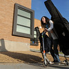 Fifth grader Gaby Anevas, 10, used her skooter to help carry her bass violin to Birch Elementary School from home for Walk To School Day on Wednesday. <br /> October 5, 2011<br /> staff photo/ David R. Jennings