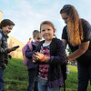 Nicole Brophy, right, readjusts intems in the backpack of her daughter, Cassidy, 6, after walking to school with Connor Syddall, 8, left, and Kaylee Syddall, 6, Walk To School Day at Birch Elementary School on Wednesday.<br /> October 5, 2011<br /> staff photo/ David R. Jennings