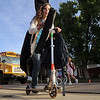 Fifth grader Gaby Anevas, 10, used her skooter to help carry her bass violin and back pack to Birch Elementary School from home for Walk To School Day on Wednesday.  <br /> October 5, 2011<br /> staff photo/ David R. Jennings