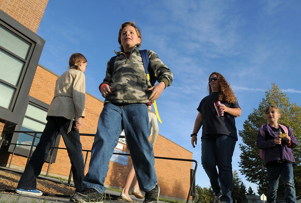 Connor Syddall, 8, walks to Birch Elementary School from home with his family for Walk To School Day on Wednesday. <br /> October 5, 2011<br /> staff photo/ David R. Jennings