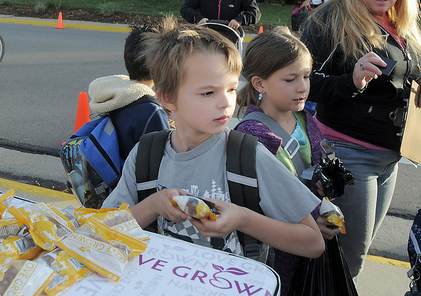 Joey Huggins, 6, picks up a granola snack at Birch Elementary School for Walk To School Day on Wednesday. <br /> October 5, 2011<br /> staff photo/ David R. Jennings