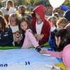 Kohl Elementary School students sign a poster acknowledging they participated in the Walk or Bike to School Day on Wednesday.<br /> <br /> October 7, 2009<br /> Staff photo/David R. Jennings