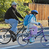Mark Gasque, left, and his daughter Jaelyn, 7, ride their bikes to school on Wednesday for Walk or Bike to School Day at Kohl Elementary School.<br /> <br /> October 7, 2009<br /> Staff photo/David R. Jennings