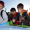 Nathan Benschop, 10, right, signs the poster while Jesse Langston, 10, watches  on Wednesday during Walk or Bike to School Day at Kohl Elementary School.<br /> <br /> October 7, 2009<br /> Staff photo/David R. Jennings
